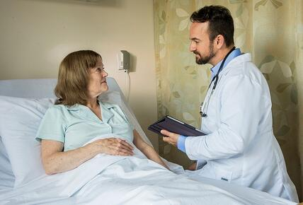 Nurse at Bedside with Patient